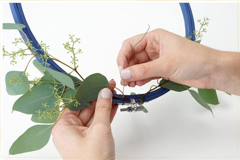 Step 2: Attach greenery with floral wire.