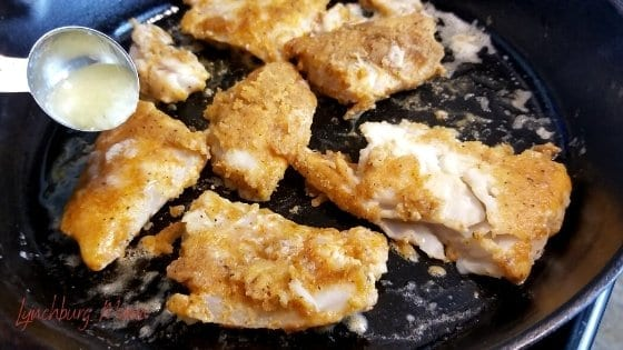 Cod Cooking in Cast Iron Adding Lemon Mix