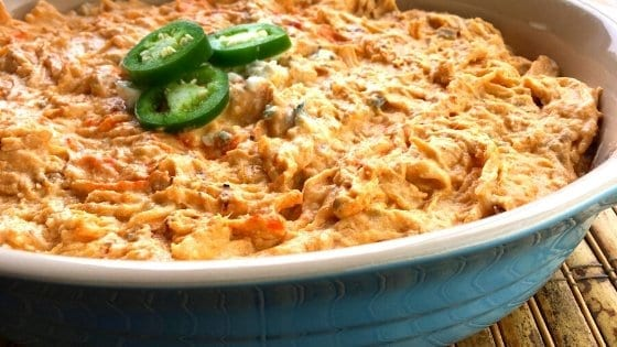 Casserole bowl of Spicy Buffalo Chicken Dip with Jalapenos on top